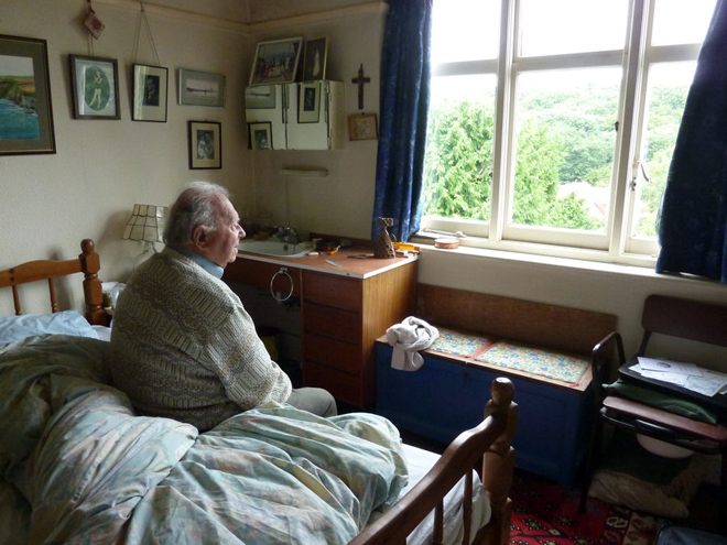 Matej in his bedroom by Eva Turrell